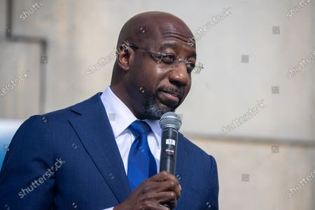 Stock Photo of Democratic senate candidate Reverend Raphael speaks to labor supporters at a canvas launch in Atlanta, Georgia on election day, January 5th.