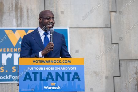 Stock Picture of Democratic senate candidate Reverend Raphael speaks to labor supporters at a canvas launch in Atlanta, Georgia on election day, January 5th.