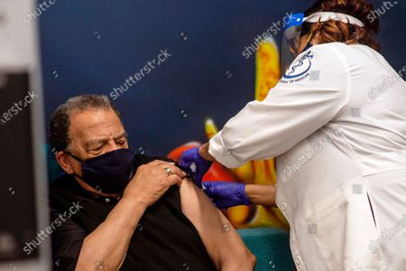 Andrew Young, former U.S. Ambassador to the United Nations receives his COVID-19 vaccination, at the Morehouse School of Medicine in Atlanta. Young, baseball great Hank Aaron and others received their vaccinations in an effort to highlight the importance of getting vaccinated for Black Americans who might be hesitant to do so