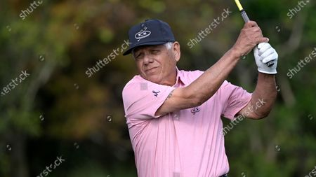 Lee Trevino watches his tee shot on the first hole during the first round of the PNC Championship golf tournament, in Orlando, Fla