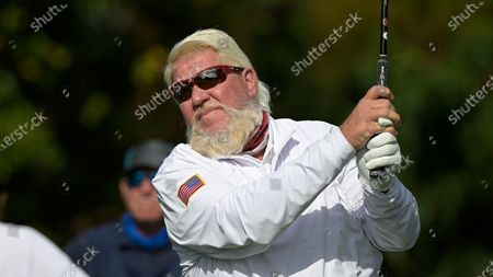 John Daly tees off on the first hole during the first round of the PNC Championship golf tournament, in Orlando, Fla
