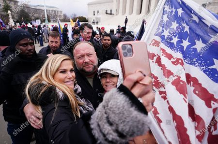 Alex Jones, radio host, greets supporters of President Donald Trump at a rally ahead of Congress's upcoming Electoral College election vote certification, in Washington, DC on Tuesday, January 5, 2021. Various groups of Trump supporters announced rallies tomorrow in support of President Trump's baseless claims of election fraud as Congress meets to certify the results of the 2020 Presidential election.