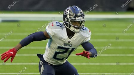 Tennessee Titans cornerback Malcolm Butler (21) defends against the Houston Texans during the first half of an NFL football game, in Houston