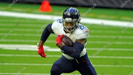 Tennessee Titans running back Derrick Henry (22) rushes for a gain against the Houston Texans during the first half of an NFL football game, in Houston