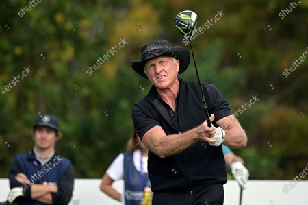 Greg Norman, of Australia, watches his tee shot on the first hole during the final round of the PNC Championship golf tournament, in Orlando, Fla