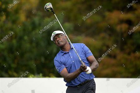 Stock Photo of Vijay Singh, of Fiji Islands, watches his tee shot on the first hole during the final round of the PNC Championship golf tournament, in Orlando, Fla