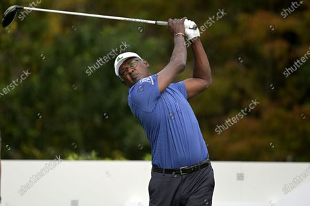Stock Image of Vijay Singh, of Fiji Islands, watches his tee shot on the first hole during the final round of the PNC Championship golf tournament, in Orlando, Fla