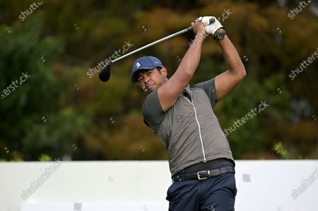 Stock Picture of Qass Singh, son of golfer Vijay Singh, watches his tee shot on the first hole during the final round of the PNC Championship golf tournament, in Orlando, Fla