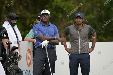 Vijay Singh, center, of Fiji Islands, and his son Qass, right, wait to hit their tee shots on the first hole during the final round of the PNC Championship golf tournament, in Orlando, Fla