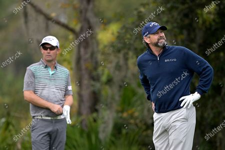 Lee Janzen, right, and Padraig Harrington, of Ireland, wait to hit their tee shots on the fourth hole during the final round of the PNC Championship golf tournament, in Orlando, Fla