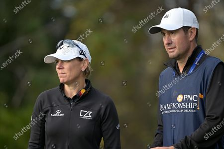 Annika Sorenstam, left, of Sweden, and her husband Mike McGee, serving as her caddie, prepare for her tee shot on the fourth hole during the final round of the PNC Championship golf tournament, in Orlando, Fla