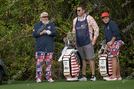 Little John Daly, right, and his father John Daly, left, wait to hit from the first fairway during the final round of the PNC Championship golf tournament, in Orlando, Fla