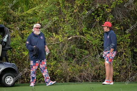 John Daly, left, and his son Little John Daly wait to hit from the first fairway during the final round of the PNC Championship golf tournament, in Orlando, Fla