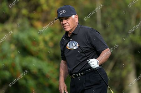 Stock Picture of Lee Trevino watches his tee shot on the first hole during the final round of the PNC Championship golf tournament, in Orlando, Fla
