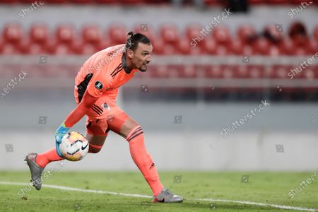 Goalkeeper Franco Armani of Argentina's River Plate holds the ball during a Copa Libertadores soccer semifinal match against Brazil's Palmeiras in Buenos Aires, Argentina