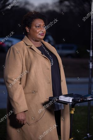 Stock Photo of Former Gubernatorial candidate Stacey Abrams gives interviews to local media and greets supporters on Election day in Atlanta, Georgia