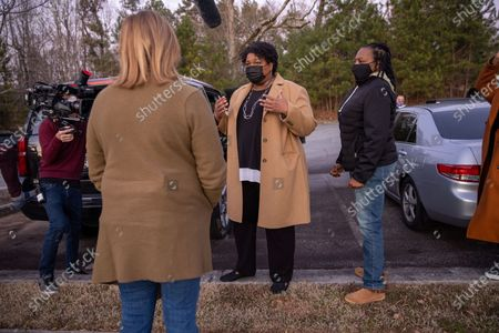 Former Gubernatorial candidate Stacey Abrams gives interviews to local media and greets supporters on Election day in Atlanta, Georgia