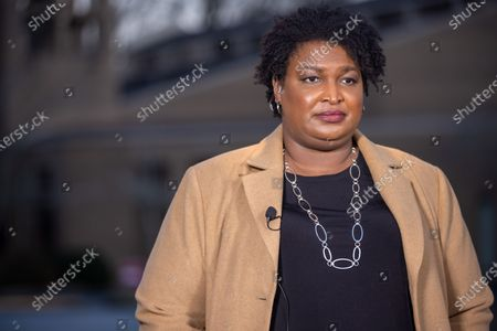Former Gubernatorial candidate Stacey Abrams gives interviews to local media and greets supporters on Election day