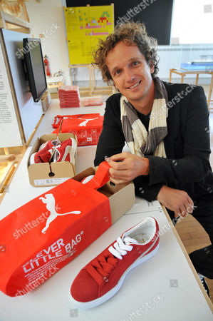 Yves Behar (Designer) with innovative new packaging and distribution system for PUMA.