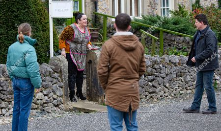 Emmerdale - Ep 8946 Tuesday 19th January 2021 Mandy Dingle, as played by Lisa Riley, kicks Paul Ashdale, as played by Reece Dinsdale, out of the salon.