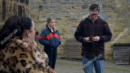 Emmerdale - Ep 8947 Wednesday 20th January 2021 Mandy Dingle, as played by Lisa Riley, and Vinny Dingle, as played by Bradley Johnson, mull over Paul's betrayal, kicking themselves for trusting him again, when Vinny's phone rings. He's shocked to hear that Paul's been taken to A&E... Also pictured - Liv Flaherty, as played by Isobel Steele.