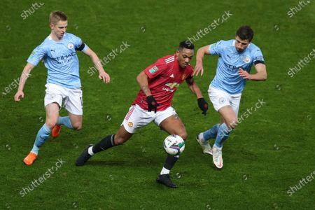 Anthony Martial of Manchester United under pressure from Ruben Dias of Manchester City and Oleksandr Zinchenko of Manchester City