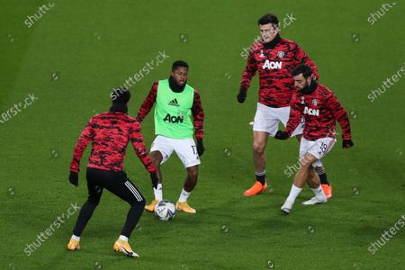 Fred of Manchester United warms up with Marcus Rashford of Manchester United, Bruno Fernandes of Manchester United and Harry Maguire of Manchester United before kick off