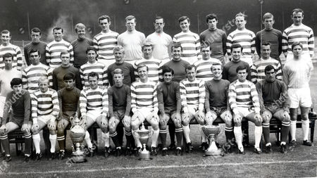 Celtic Football Club Team Group In The 1960's With Their Trophies. (back Row L-r) Jim Brogan Danny Mcgrain Joe Mcbride Dave Cattanach George Connelly John Fallon Ronnie Simpson Charlie Gallagher Quinn John Clark Kenny Dalgleish Willie O'neil. (middle Row L-r) Wraith John Hughes David Hay Jim Craig Jackie Clarke Tommy Gemmell Mckellar Bobby Murdoch Murray Steve Chalmers Livingstone. (front Row L-r) Mcmahon Jimmy Johnstone (died 3/06) Lou Macari Willie Wallace Davidson Billy Mcneill Wilson Bobby Lennox Jim Clarke Bertie Auld John Gorman. (trophies L-r) The Glasgow Cup The League Championship Cup And The League Cup.