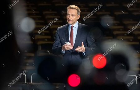 Stock Picture of Leader of Free Democratic Party (FDP), Christian Lindner speaks on stage inside of the empty Opera during the traditional Epiphany meeting (Dreikoenigstreffen) in Stuttgart, Germany, 06 January 2021. Due to the ongoing Corona virus pandemic, viewers will only be able to watch the Epiphany meeting online via livestream. The federal elections will be held in Germany this year on 26 September.
