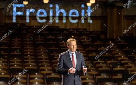 Stock Photo of Leader of Free Democratic Party (FDP), Christian Lindner speaks on stage inside of the empty Opera during the traditional Epiphany meeting (Dreikoenigstreffen) in Stuttgart, Germany, 06 January 2021. Due to the ongoing Corona virus pandemic, viewers will only be able to watch the Epiphany meeting online via livestream. The federal elections will be held in Germany this year on 26 September.
