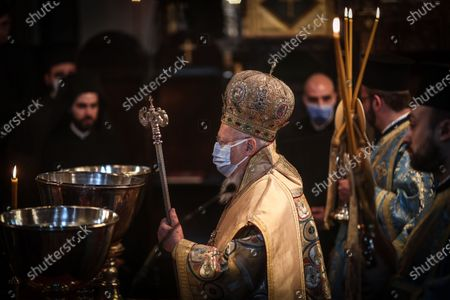 Greek Orthodox Ecumenical Patriarch Bartholomew I (C) of Constantinople leads the service during the Epiphany Day ceremony in Istanbul, Turkey, 06 January 2021.