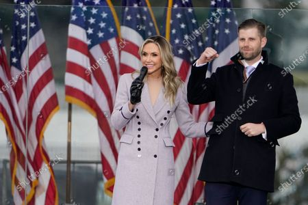 """Lara Trump speaks as she stands on stage with her husband Eric Trump, in Washington, at a rally in support of President Donald Trump called the """"Save America Rally"""