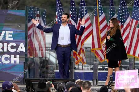 """Donald Trump Jr. arrives on stage as Kimberly Guilfoyle speaks, in Washington, at a rally in support of President Donald Trump called the """"Save America Rally"""