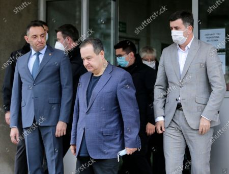 Serbian Interior Minister Aleksandar Vulin (L) and Serbian parliament speaker Ivica Dacic (C) arrive to address the media after receiving a shot of Russian Sputnik V coronavirus vaccine in in Belgrade, Serbia, 06 January 2021. Serbia is the only Western Balkan nation to receive vaccine shots so far, getting deliveries from Pfizer-BioNTech and the Russian-developed Sputnik V vaccine but still not enough to start mass vaccination.