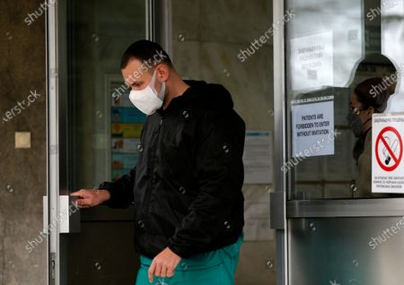 Stock Picture of A medical worker holds the door before the arrival of Serbian Interior Minister Aleksandar Vulin and Serbian parliament speaker Ivica Dacic to take a shot of Russian Sputnik V coronavirus vaccine in in Belgrade, Serbia, 06 January 2021. Serbia is the only Western Balkan nation to receive vaccine shots so far, getting deliveries from Pfizer-BioNTech and the Russian-developed Sputnik V vaccine but still not enough to start mass vaccination.