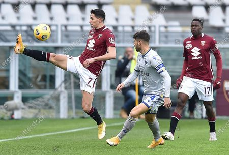 Torino's Sasa Lukic (L) and Miguel Veloso of Hellas Verona in action during the Italian Serie A soccer match Torino FC vs Hellas Verona FC at the Olimpico Grande Torino Stadium in Turin, Italy, 06 January 2021.