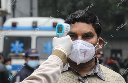 A health worker uses a thermal gun to check temperature while testing a vaccine process during the dry run (mock drill) to test the mechanisms for covid-19 vaccine. Beneficiaries register themselves through Co-WIN official vaccine app for India. India requires a total of 6.6 crore doses of coronavirus vaccines to inoculate healthcare and frontline workers in which over 75 lakh health workers registered themselves. Indian Union Health Minister Dr. Harsh Vardhan announced that vaccination will be free for frontline workers.