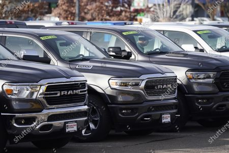 Long row of unsold 2020 pickup trucks sits at a Ram dealership, in Littleton, Colo. A new government report says gas mileage for new vehicles dropped and pollution increased in model year 2019 for the first time in five years