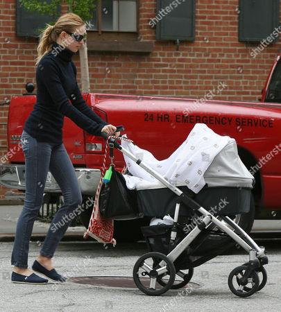 Karolina Kurkova walking with her baby son Tobin Jack Drury in his pram.