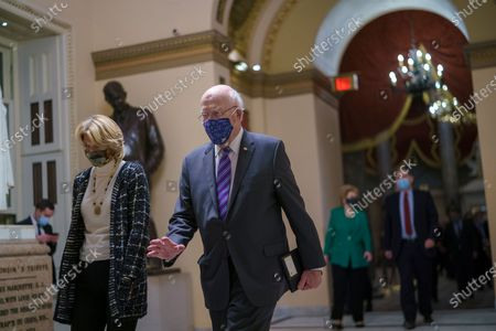 After violent protesters loyal to President Donald Trump stormed the U.S. Capitol today, Sen. Lisa Murkowski, R-Alaska, left, and Sen. Patrick Leahy, D-Vt., join other senators as they return to the House chamber to continue the joint session of the House and Senate and count the Electoral College votes cast in November's election, at the Capitol in Washington