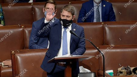 In this image from video, Rep. Ruben Gallego, D-Ariz., speaks as the House reconvenes to debate the objection to confirm the Electoral College vote from Arizona, after protesters stormed into the U.S. Capitol on
