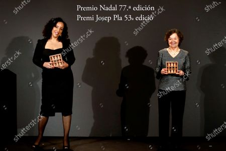 Moroccan-Spanish writer Najat El Hachmi poses with the Nadal Award for her novel 'El lunes nos querren' (Monday they will love us) next to Spanish writer Maria Barbal (R), winner of the Josep Pla Award for her novel 'Tandem,' during the 77th Nadal Award and 53rd Josep Pla Prize handover ceremony in Barcelona, Spain, 06 January 2021. The Nadal literary prize and the Josep Pla Award for Catalan literature are given out at the same ceremony by the Spanish publishing house Destino.