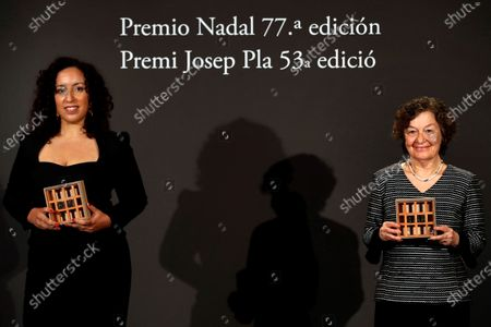 Stock Image of Moroccan-Spanish writer Najat El Hachmi poses with the Nadal Award for her novel 'El lunes nos querren' (Monday they will love us) next to Spanish writer Maria Barbal (R), winner of the Josep Pla Award for her novel 'Tandem,' during the 77th Nadal Award and 53rd Josep Pla Prize handover ceremony in Barcelona, Spain, 06 January 2021. The Nadal literary prize and the Josep Pla Award for Catalan literature are given out at the same ceremony by the Spanish publishing house Destino.