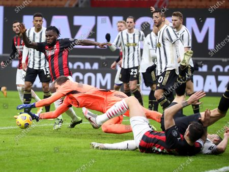 Stock Image of Juventus' goalkeeper Wojciech Szczesny jumps for the ball during the Italian serie A soccer match  between Ac Milan and Juventus FC at Giuseppe Meazza stadium in Milan, Italy, 06 January 2021.