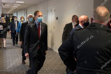 United States Senator Richard Blumenthal (Democrat of Connecticut) and other Senators evacuate to a safe place in the Dirksen Senate Office Building after Electoral votes being counted during a joint session of the United States Congress to certify the results of the 2020 presidential election in the US House of Representatives Chamber in the US Capitol in Washington, DC, as interrupted as thousands of pr-Trump protestors stormed the U.S. Capitol and the House chambers. .