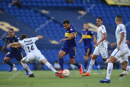 Luan Peres of Brazil's Santos challenges for the ball Eduardo Salvio of Argentina's Boca Juniors during a Copa Libertadores semifinal first leg soccer match at the Bombonera stadium in Buenos Aires, Argentina
