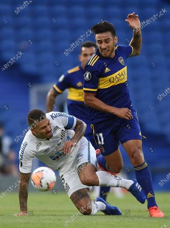 Stock Picture of Eduardo Salvio of Argentina's Boca Juniors, right, and Alison of Brazil's Santos vie for the ball during a Copa Libertadores semifinal first leg soccer match at the Bombonera stadium in Buenos Aires, Argentina
