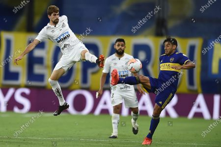 Stock Image of Luan Peres of Brazil's Santos, left, and Eduardo Salvio of Argentina's Boca Juniors battle for the ball during a Copa Libertadores semifinal first leg soccer match at the Bombonera stadium in Buenos Aires, Argentina