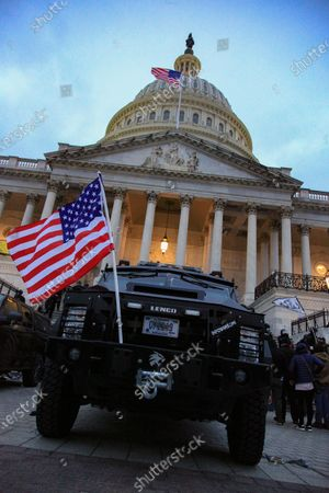 The Infowars.com vehicle sits parked in a restricted area on the east side of the U.S. Capitol building. Alex Jones, a popular conspiracy theorist was involved in and present at the rallies on Wednesday