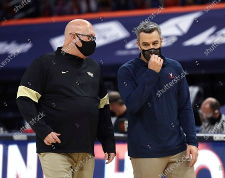 Wake Forest coach Steve Forbes, left, and Virginia coach Tony Bennett talk after an NCAA college basketball game, in Charlottesville, Va